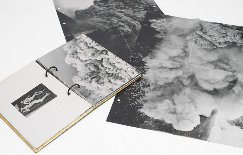 The photobook hides photographs that can only be seen as a hole if the reader opens the rings that bind the book together.